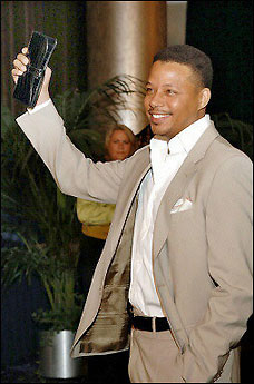 Terrence Howard and Man Purse at the Oscars