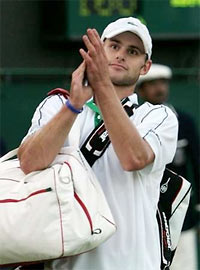 Andy Roddick Carrying Two Man Bags